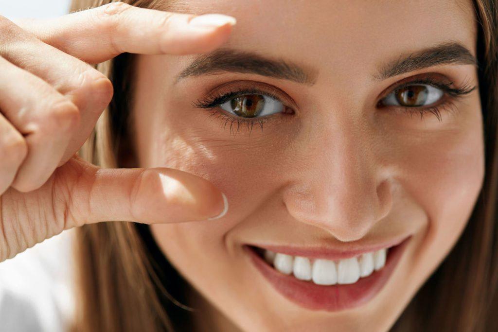 Closeup Of Beautiful Smiling Young Woman With Natural Makeup