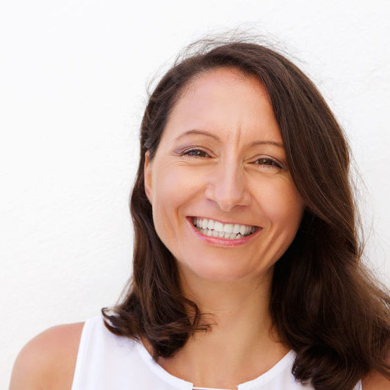 42743856 - close up portrait of a smiling mid adult woman posing against white background